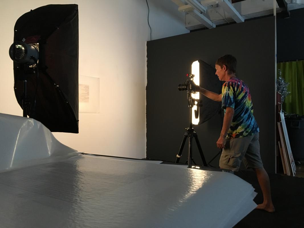Elena Bouvier shooting Stella Untalan's drawings.